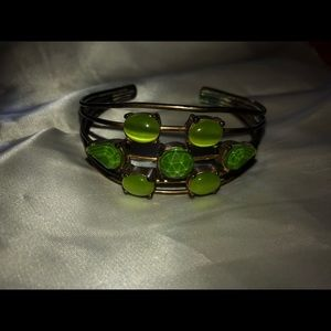 Vintage gold tone cuff bracelet with green glass